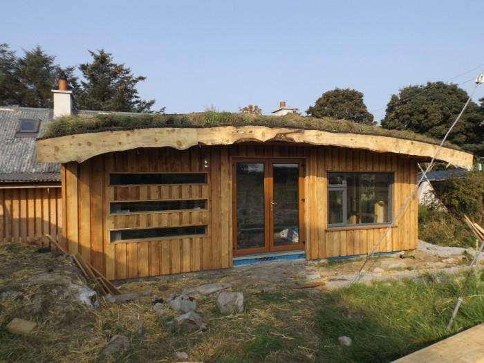 Timber frame with a strawbale insulated green roof (roundwood and ...