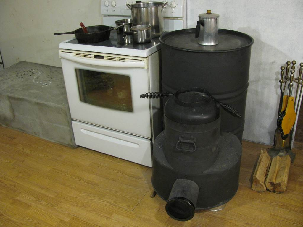 First rocket stove heats water with pics rocket mass for Rocket stove mass water heater