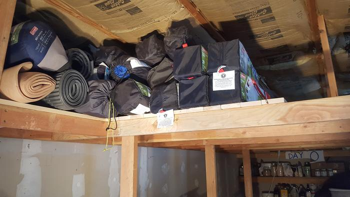 Storing camping supplies on the new shelving