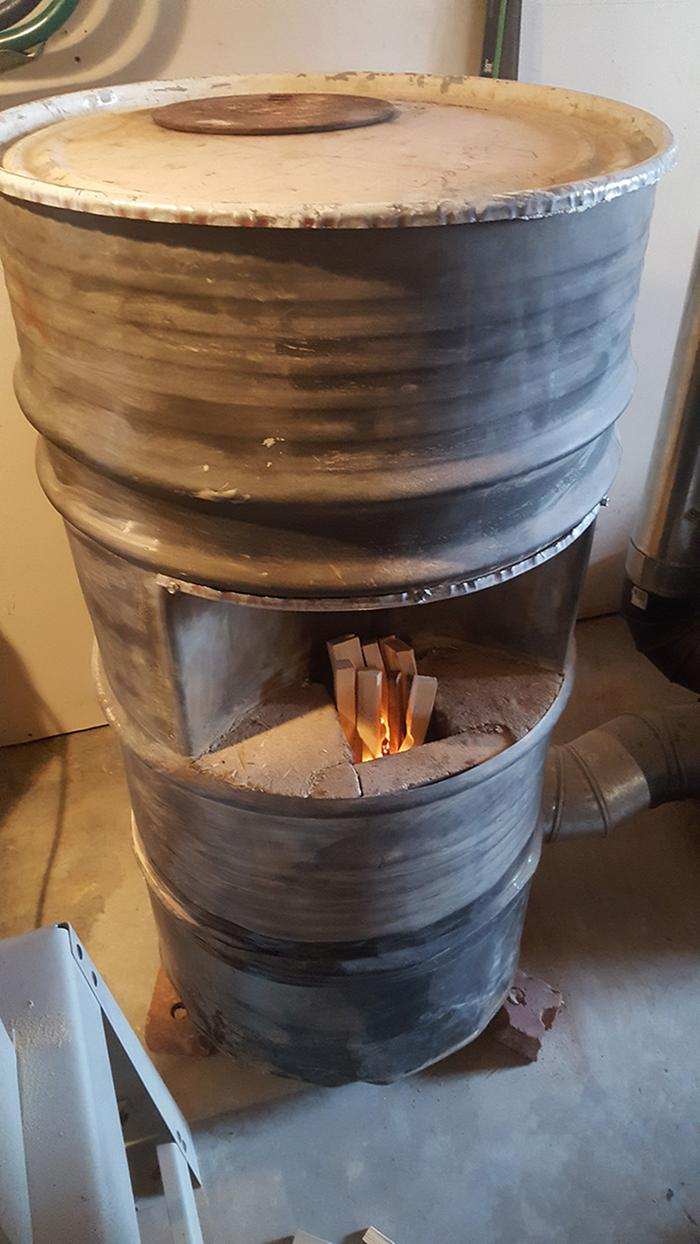 Rocket Mass Heater in The Shop built by Uncle Mud.
