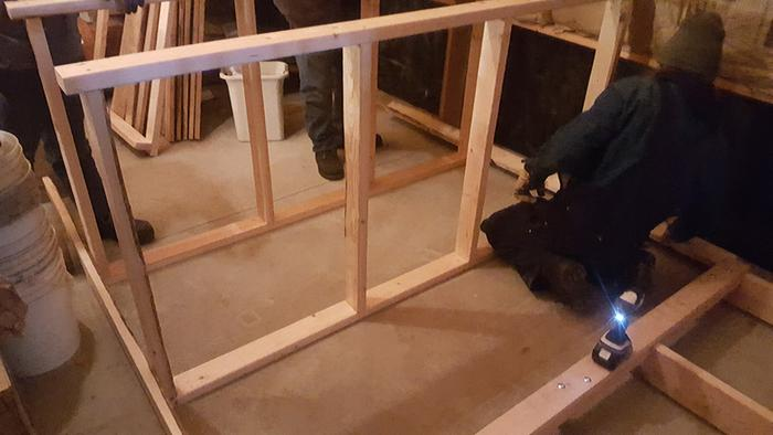 Attaching supports to shelves
