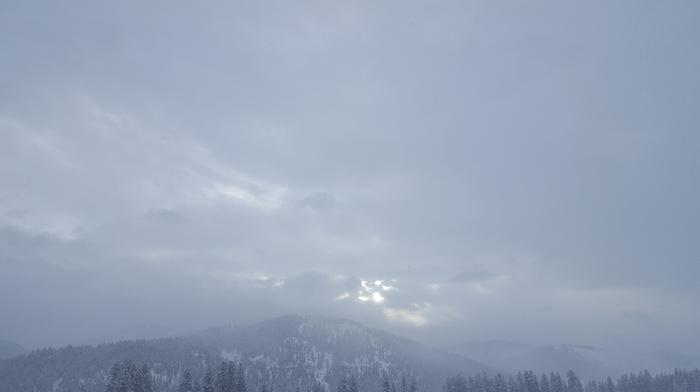 Winter sun rising, beautiful mist over the mountains