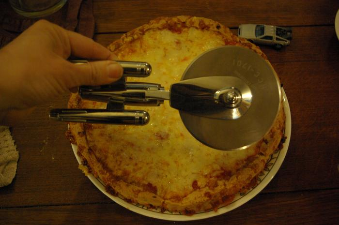 Duuun-dun-dun-dun-dun-dun-dududuuuuuun! (Star Trek music to go with our pizza cutter)