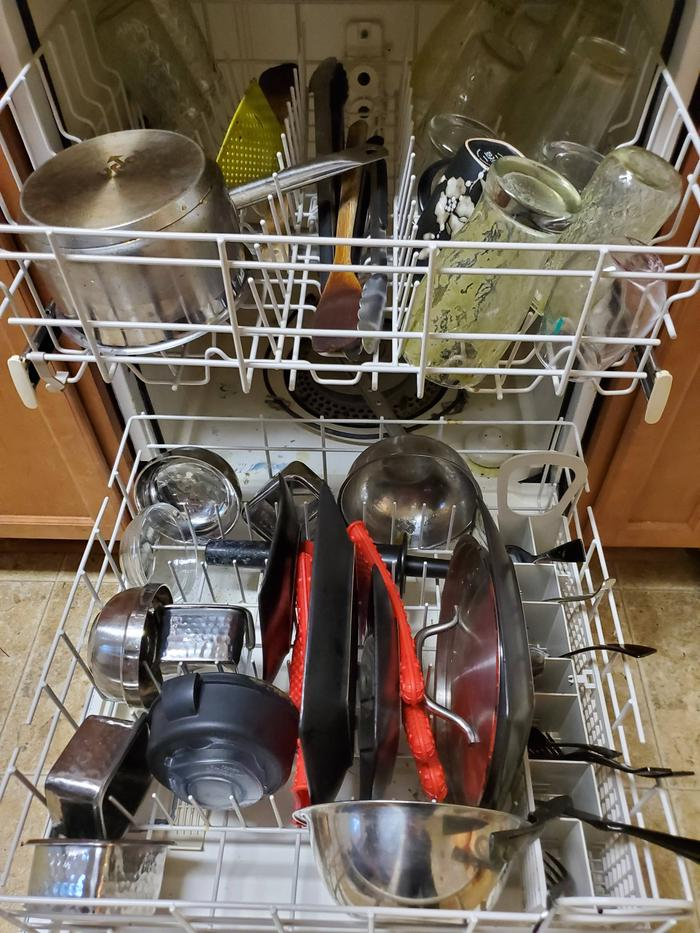 dishwasher full of dirty dishes.