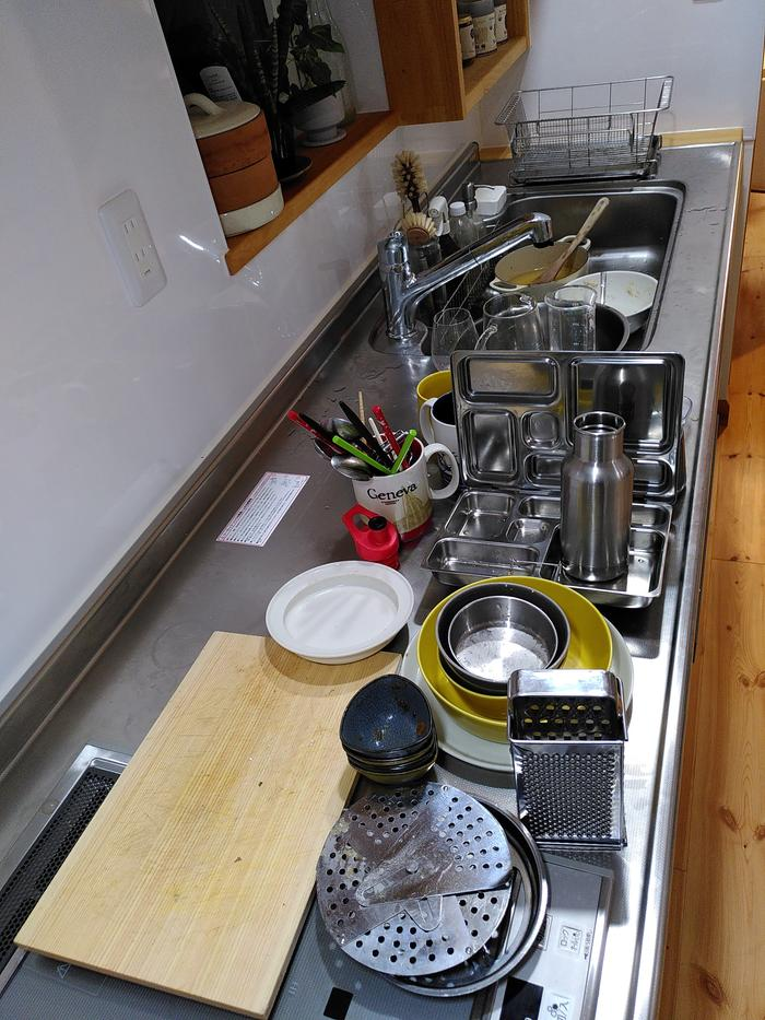 Dirty dishes all lined up in order of dirtiness
