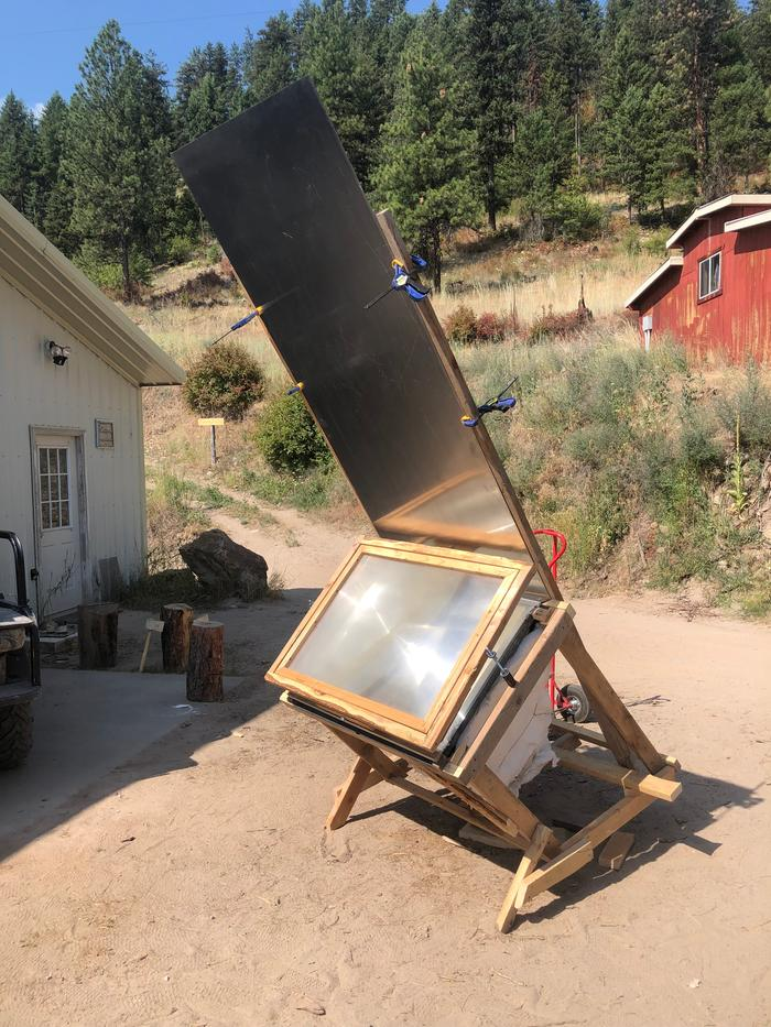 I found a large sheet of stainless steel in the shop and decided to build a reflector like solar ovens have