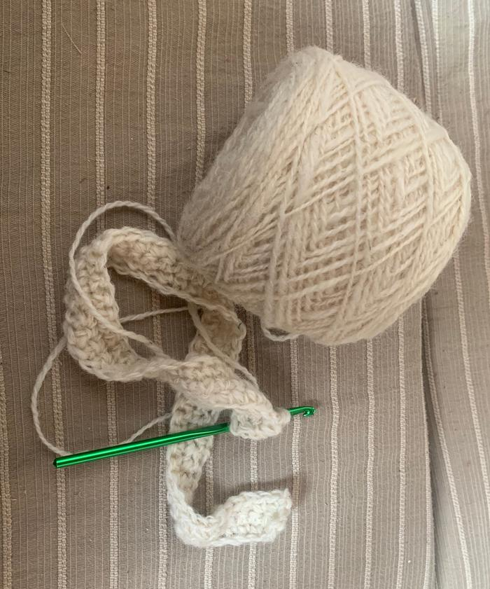 Starting to crochet an insulative insert for the single-pane window in the back door using yarn Inge sent