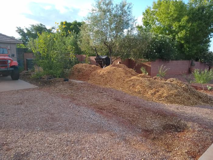 where every delivery of wood chips comes in, a long walk from where most of them go, all by a wheel barrow.