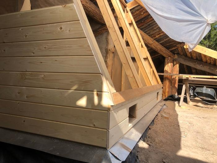wooden siding on greenhouse