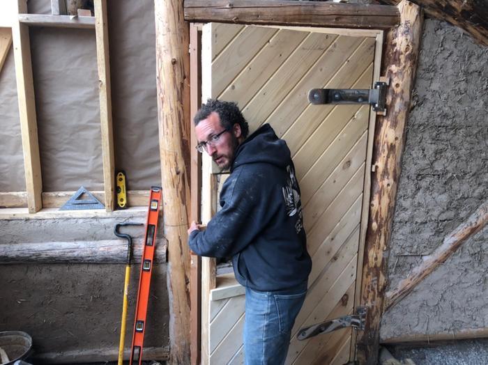 kyle and his handmade wooden door