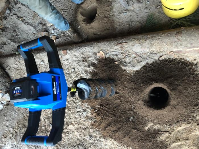 Testing the new electric post hole digger.