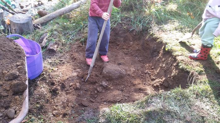 They had a lot of fun trying to scrape it level with the hoe--my son actually hoisted that rock out of the ground with a shovel as a lever!