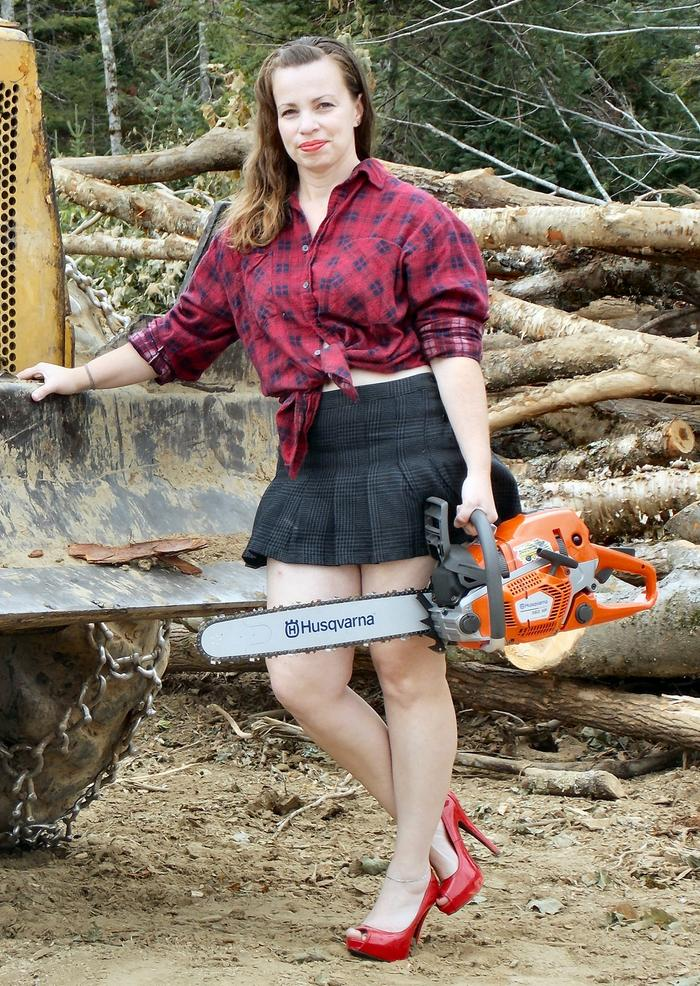 [Thumbnail for Katie-Holding-Chainsaw.jpg]
