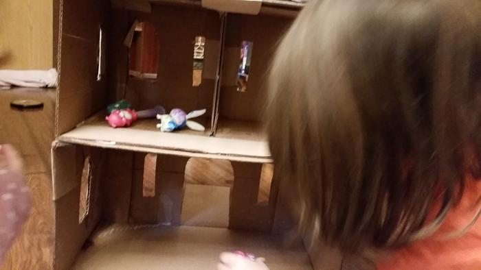 inside of half-done cardboard dollhouse castle