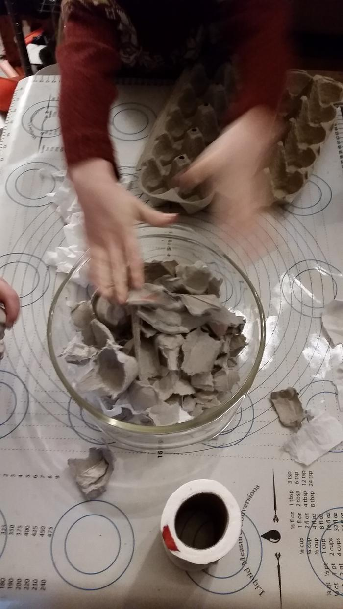 ripping egg cartons for paper mache clay