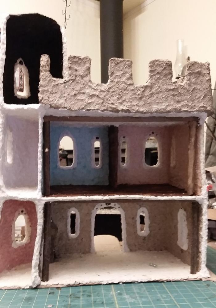 paper clay castle with blue, grey, pink and white walls