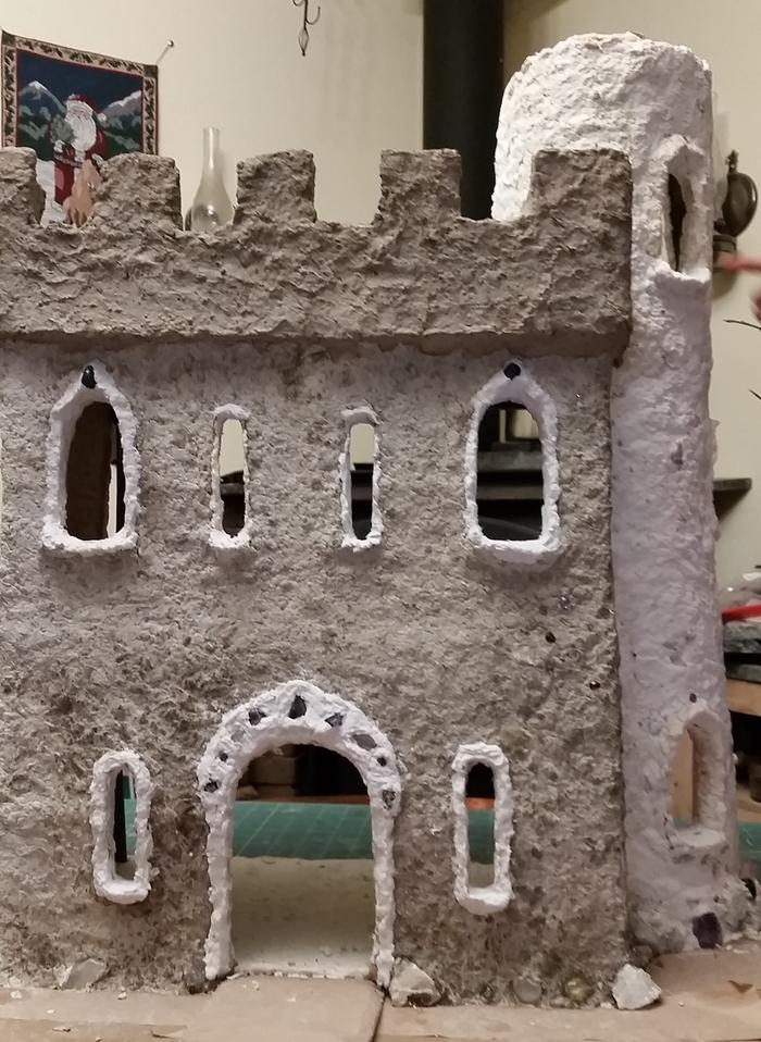 cardboard castle with white trim, grey walls, and gemstones