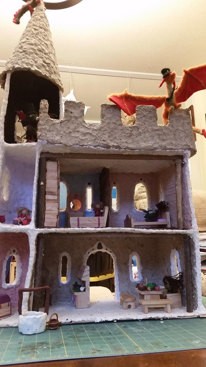 handmade castle with waldorf dolls and mellissa doug furniture