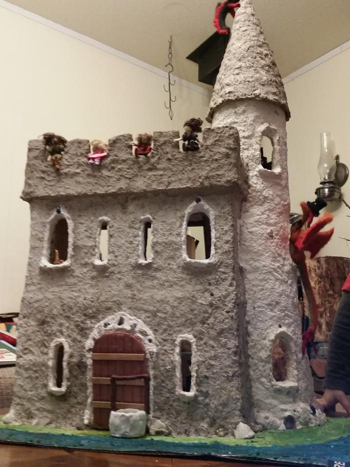 DIY cardboard and paper clay mache castle with popsicle stick drawbridge