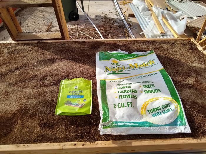 Turkey compost on top with a bag of the organic fert.