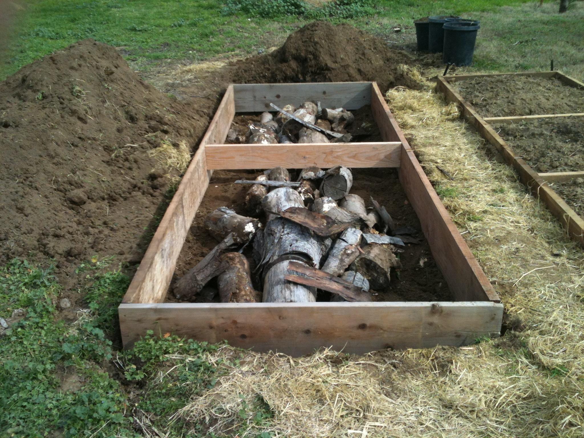 Example Of Hugelkultur In Raised Garden Beds.