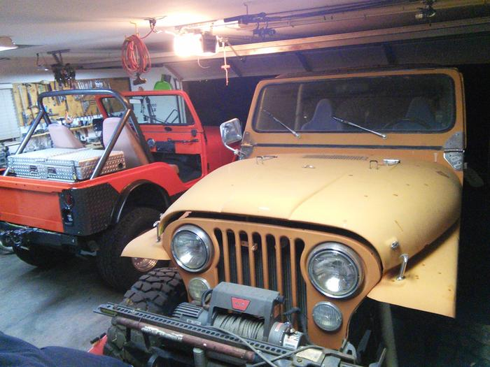 Two current jeeps taking up room in the shop/garage. Picture is a few years old, but it looks the same today