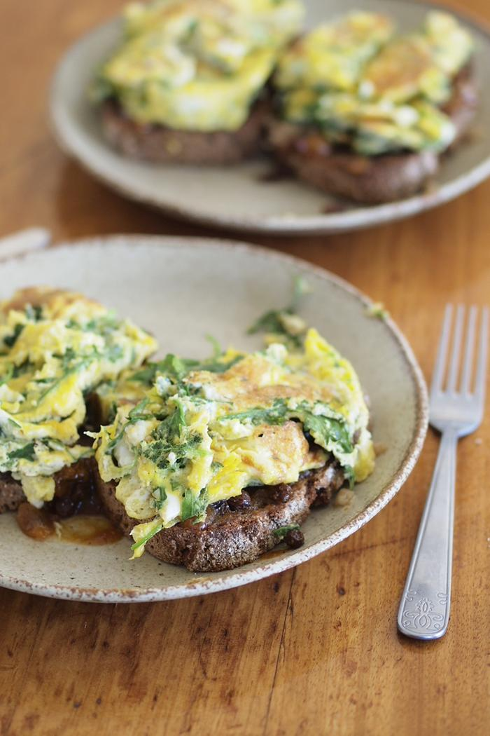 Egg and green slabs on toast