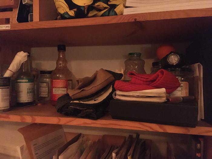 My cubby has my bare essentials plus some empty jars.. I don't know why I have such a fascination with containers.. i like boxes also, but they don't fit in my cubby