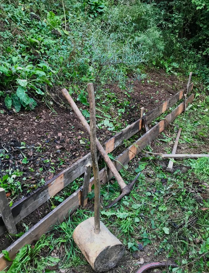 A quick and dirty way of boarding up the sawdust beds in the orchard