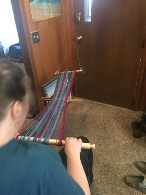 Putting the warp on the loom and securing it to the loom bars