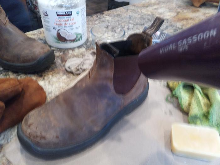 Heating up the beeswax on my dad's boots