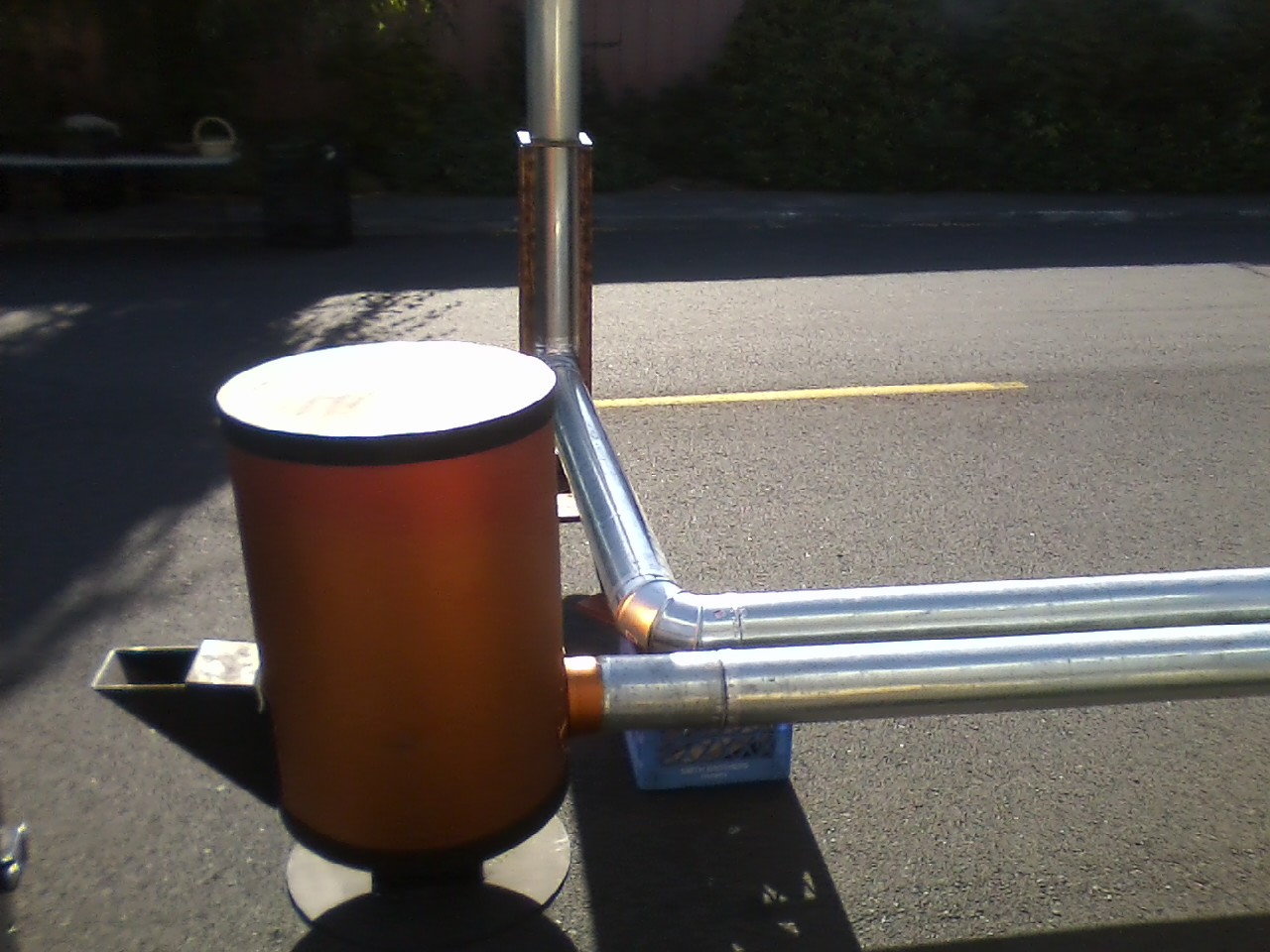 Rocket mass heater that looks modern and works amazing for Rocket stove mass water heater