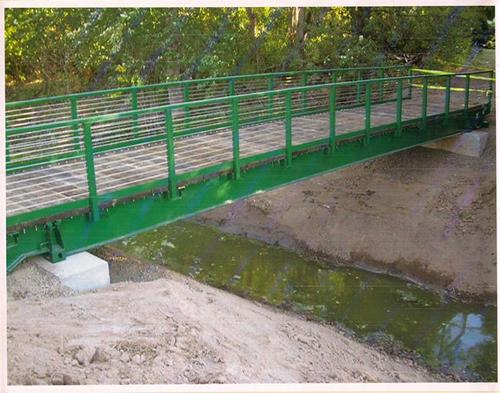 Railcar bridges earthworks forum at permies for Garden pond bridges sale