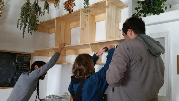 Fred, Robbie, and Philip hanging new custom shelves