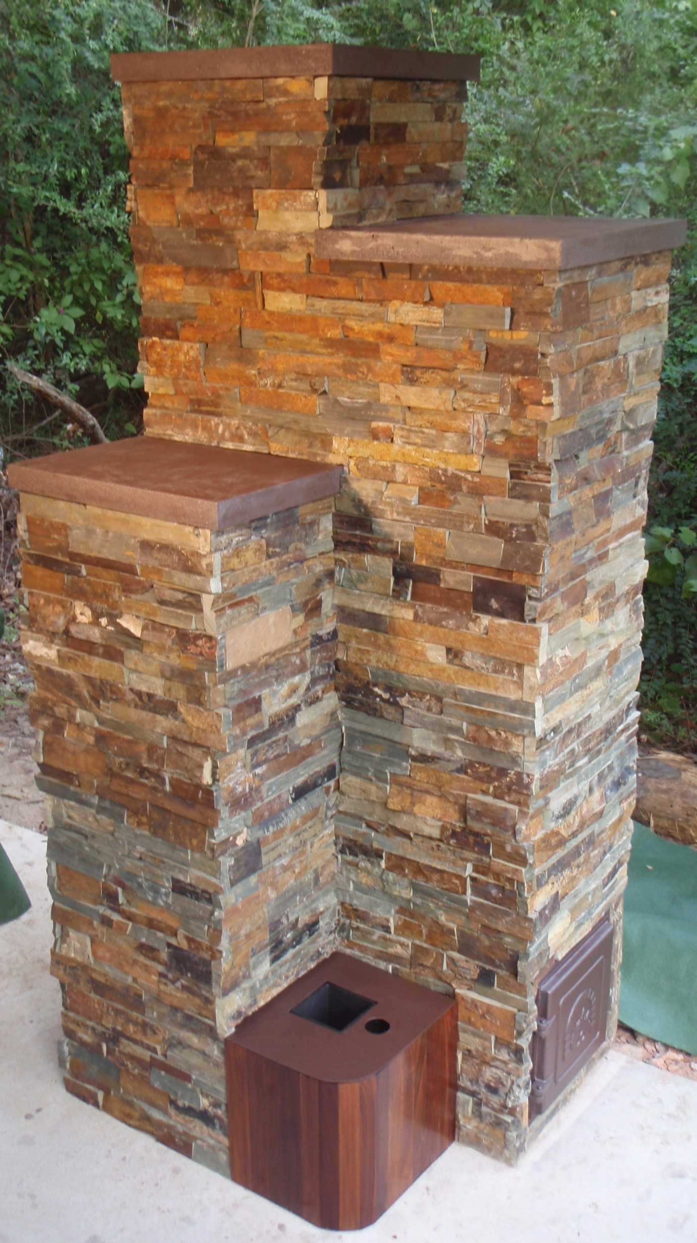 Rocket Heater Masonry Stove Built Using Flue Pipes And A