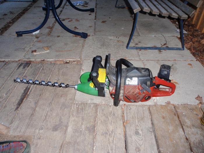 My chainsaw engine with the drill attachment and a 30mm x 450mm auger