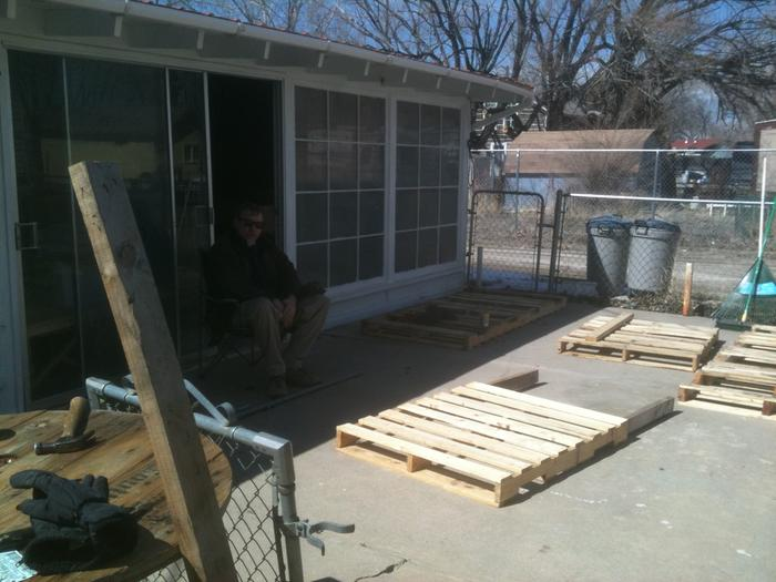 Constructing the fence - note the splines--ready to join the two pallets together. Also look at the lovely alley.