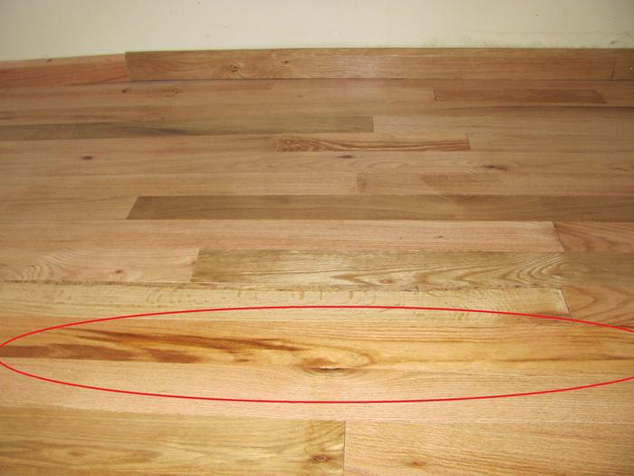 The flooring is mostly oak with a few locust boards mixed in