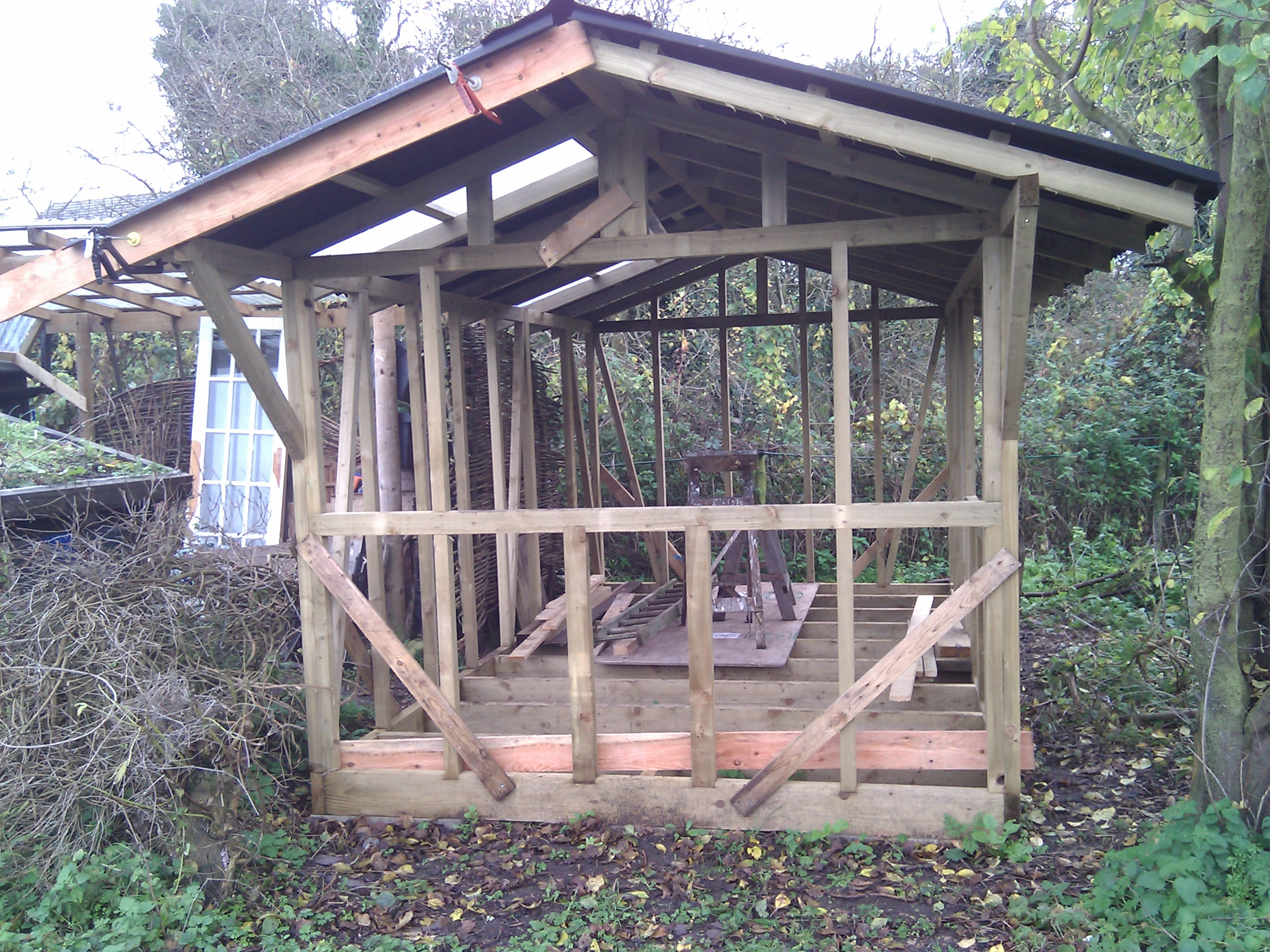 using pallets for external cladding (woodworking forum at permies)