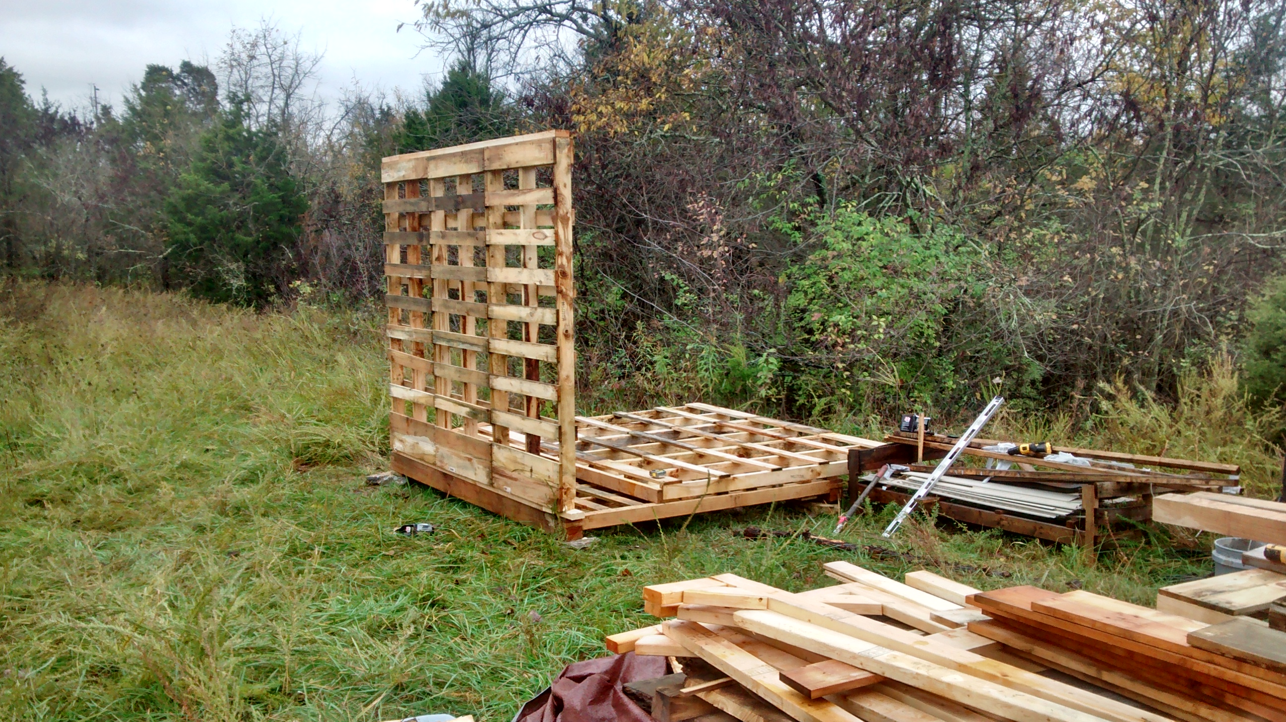 Pallet shed with greenhouse and firewood adjucts for Build a greenhouse from pallets