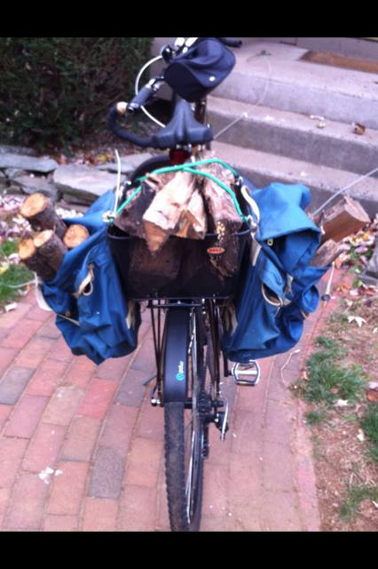bicycle hauling firewood in basket and panniers