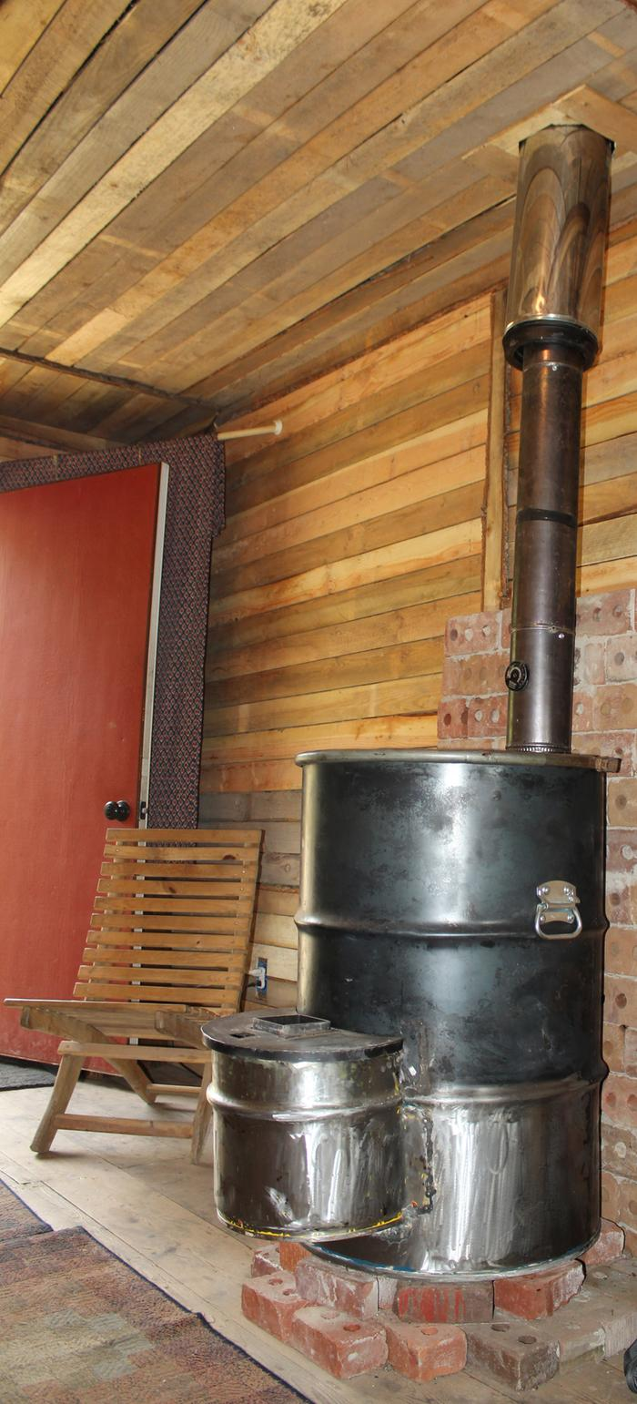 red cabin hike camp permaculture rocket mass stove heater
