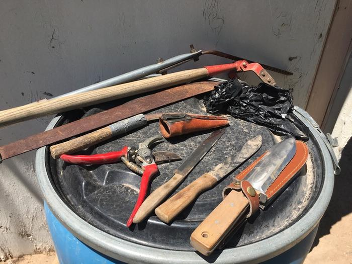 chop-and-drop tools arrayed on a rain barrel
