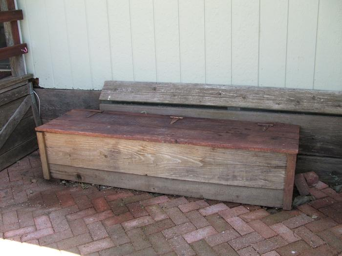 Worm box bench made of recycled redwood fence boards