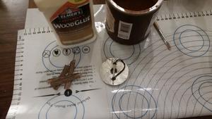 wood glue, cheap cocoa powder, and strips of paper