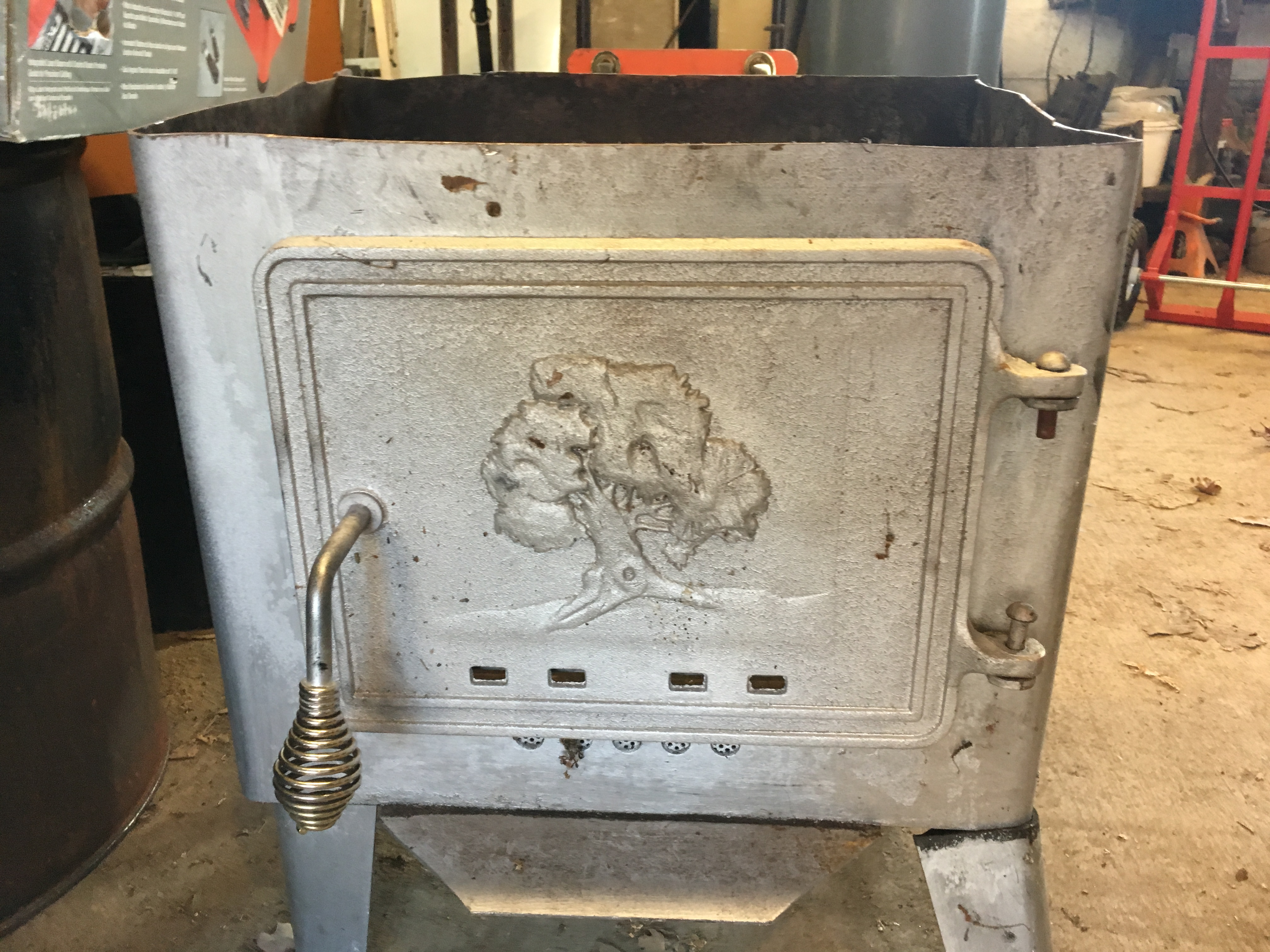 Putting Glass In An Old Cast Iron Wood Stove Door Rocket Mass