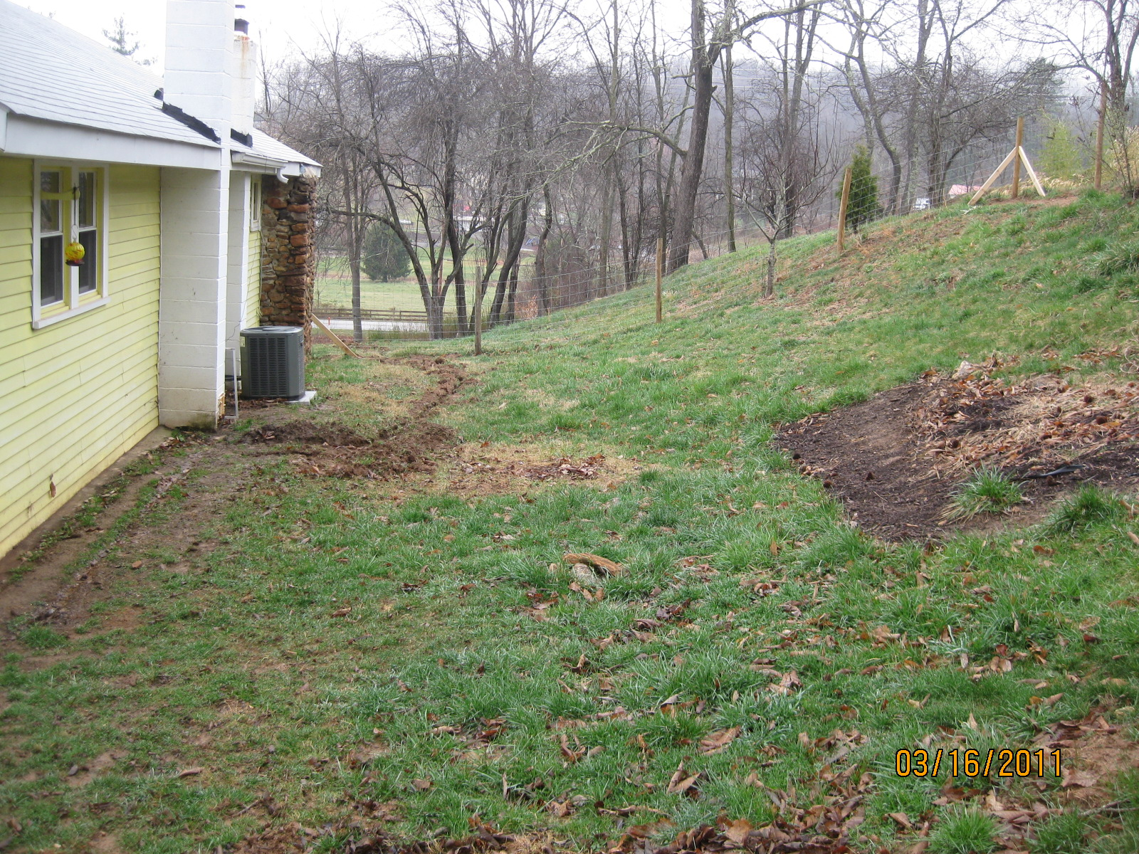 Backyard slopes away from house 28 images backyard for Yard drainage slope