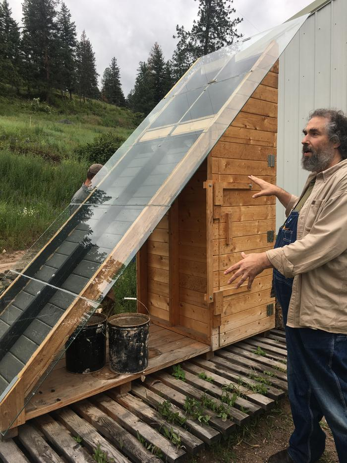 [Thumbnail for Paul-describing-the-solar-dehydrator-during-the-tour-of-basecamp..jpg]