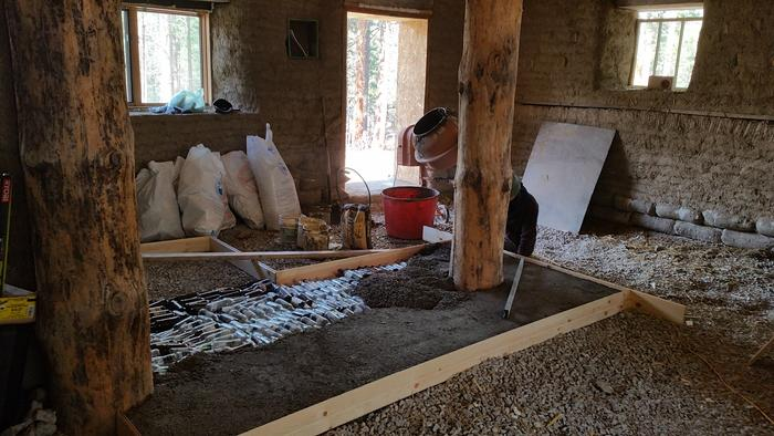 perlite cement going in as pad for bench and stove