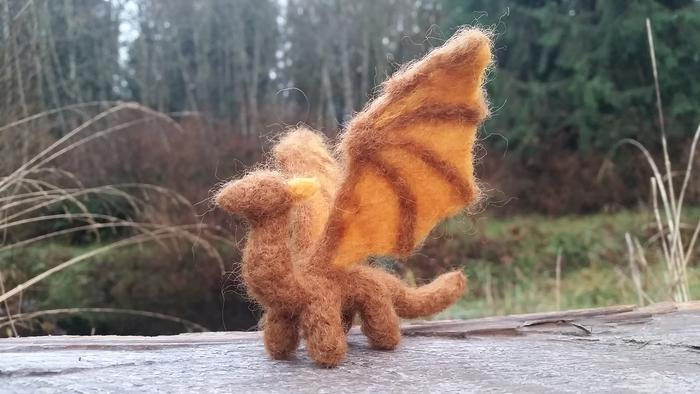 brown and orange earthtone wool dragon